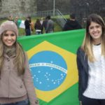 2 girl students hold brazil flag